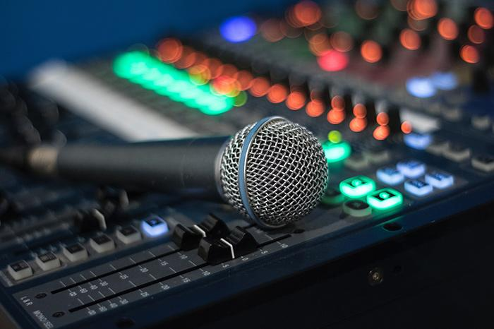 Microphone lies on audio mixer